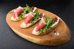 Appetizer bruschetta with tomato and bacon Stock Image