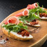 Appetizer bruschetta with tomato and bacon Royalty Free Stock Photography