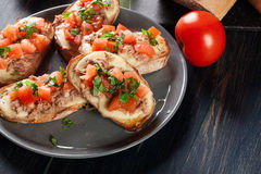 Appetizer bruschetta with tuna, mozarella cheese and tomatoes Stock Photography