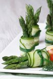 Appetizer buffet: beautiful cucumber rolls with asparagus Royalty Free Stock Photography