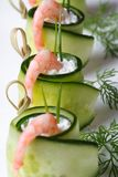 Appetizer buffet: cucumber rolls with shrimp vertical macro Royalty Free Stock Photos