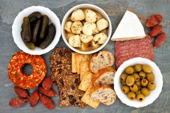 Appetizer buffet over a slate background Royalty Free Stock Photos