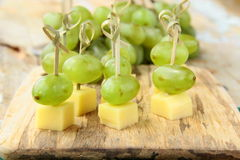 Appetizer canape cheese with white grapes Stock Photography