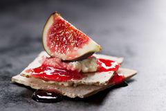 Appetizer canape with fig, jam and cheese on a small loaf of bread Stock Photography
