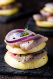 Appetizer canape with herring, apples Royalty Free Stock Photography