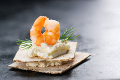 Appetizer canape with shrimp, cheese and dill on a small loaf of bread Royalty Free Stock Images