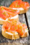 Appetizer canapes of baguette with smoked salmon Stock Image