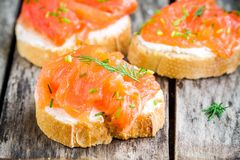 Appetizer canapes of baguette with smoked salmon Royalty Free Stock Images