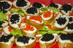 Appetizer with caviar. Food. delicacy. sandwich with red and black caviar stock photography