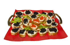 Appetizer with caviar. Food. delicacy. sandwich with red and black caviar on a tray royalty free stock photography