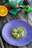 Appetizer ceviche with raw scallop and sauce. Vertical Royalty Free Stock Photos