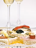 Appetizer and champagne. Appetizer with caviar, champagne and other delights Stock Photos