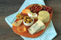 Appetizer with cheese and fruits Royalty Free Stock Photo