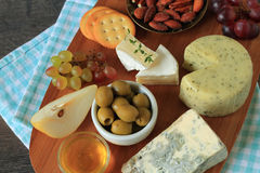 Appetizer with cheese and fruits Stock Photo