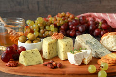 Appetizer with cheese and fruits Stock Images