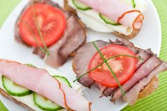 Appetizer of cheese, ham, beef and cucumber Stock Photos