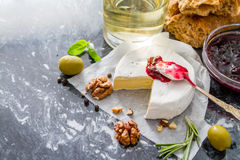 Appetizer - cheese ham bread tomato basil nuts wine Stock Images