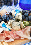 Appetizer with cheese, ham and grape Stock Images