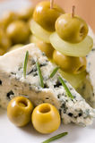 Appetizer cheese, olives and grapes Royalty Free Stock Photography