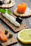 Appetizer with cheese,olives and red fish. Selective focus Stock Photo