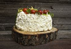 Appetizer with cheese and vegetables. Bright tasty snack cake with mascarpone and cherry for a summer party on a wooden background Stock Images