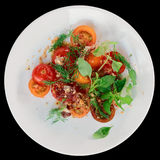 Appetizer with cherry tomatoes and smoked duck fillet Royalty Free Stock Photo