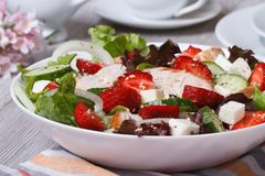 Appetizer of chicken fillet, strawberries, vegetables and sesame. Seeds close up on the table. horizontal Stock Images