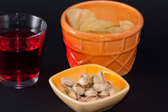 Appetizer chips and pistachios Stock Photo