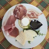 Appetizer of cold cuts and cheeses with honey Stock Images