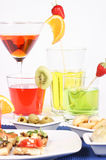 Appetizer and colored aperitif drinks Royalty Free Stock Images