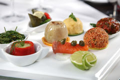 Appetizer composition. A composition of appetizer with vegetable and fish Royalty Free Stock Photography