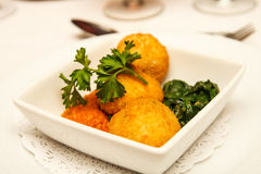 Conch Fritters and Parsley. An appetizer of conch fritters with sauce, gsarnish and parsley Stock Photo