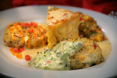 Appetizer with Crab Cakes, Cream Sauce, Cheese royalty free stock image
