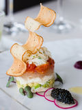 Appetizer with crab, salmon and vegetables Royalty Free Stock Photos