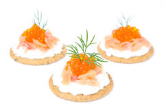 Appetizer crackers with cream cheese, salted salmon, red caviar Stock Photos