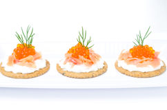 Appetizer crackers with cream cheese, salted salmon Royalty Free Stock Photography