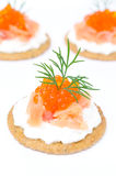 Appetizer crackers with cream cheese, salted salmon, red caviar Stock Photography
