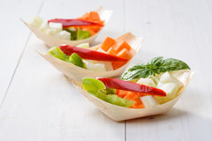 Appetizer with crudites. Appetizer with raw vegetables, crudites in bamboo boat's Royalty Free Stock Image