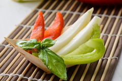 Appetizer with crudites. Appetizer with raw vegetables, crudites in bamboo boats, close-up Stock Image