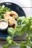 Appetizer. Crunchy stuffed calzone with garlic yoghurt sauce. royalty free stock image