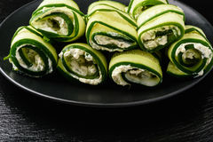 Appetizer - cucumber rolls stuffed  with cream cheese, garlic and parsley. Royalty Free Stock Photos