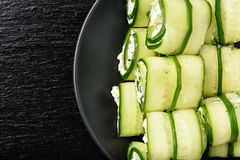 Appetizer - cucumber rolls stuffed  with cream cheese, garlic and parsley. Stock Image