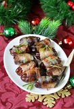 Appetizer delicacy dates wrapped in bacon Stock Image