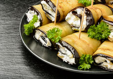 Appetizer - eggplant rolls stuffed with creme cheese, garlic and greens. Royalty Free Stock Image
