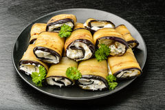 Appetizer - eggplant rolls stuffed with creme cheese, garlic and greens. Stock Photo