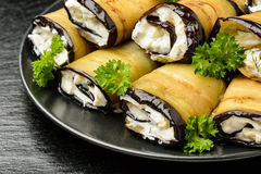 Appetizer - eggplant rolls stuffed with creme cheese , garlic and greens. Royalty Free Stock Image