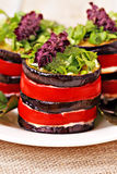 Appetizer of eggplant and tomato with basil Stock Photo