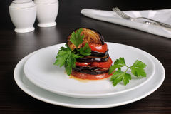 Appetizer eggplant with tomatoes Stock Photos