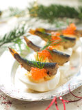 Appetizer. Eggs stuffed with yolk, caviar and fish, selective focus Royalty Free Stock Photo