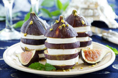 Appetizer of figs and brie cheese Stock Images